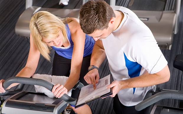 Good PTs will use a thorough set of notes to inform your training (PIC: Alamy)